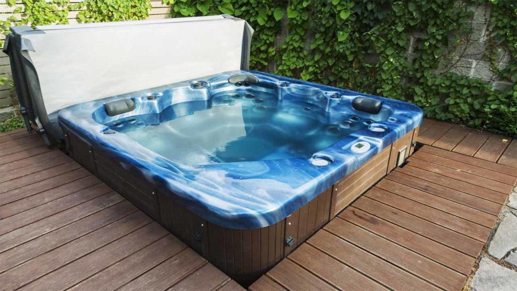 If you are wondering if can you put a hot tub in the ground then you are in the right place. Just like grass, you can't put a hot tub in the ground without some reinforcements. Using concrete as a base would be the perfect solution.